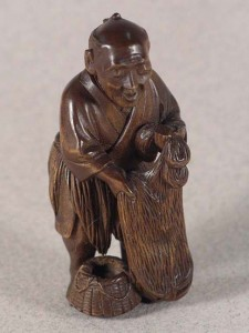 Netsuke, Kyokusai, wood, late C 19th, height 5.3cm tall, EA1996.20