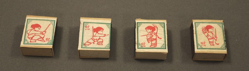 Four matchboxes with small girls practicing martial arts, EA2010.95