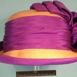 Cloche straw hat with purple silk ribbon decoaration.